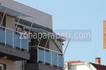 изработка на парапети за балкони от инокс и синьо стъкло